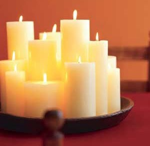 Using different candles for different spaces is an affordable way to decorate