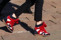 Knowing how to wear wedge sneakers gives your fashion a kick