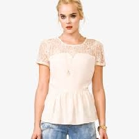 Learn what to wear under a sheer lace top to make a fashion statement