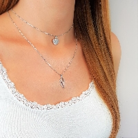 Create a fun and stylish look with layered necklaces